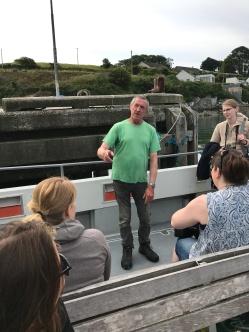 Colin briefs his passengers